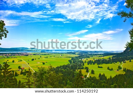 Bavaria landscape from Neuschwanstein castle. Schwangau village and Forggensee lake on background.