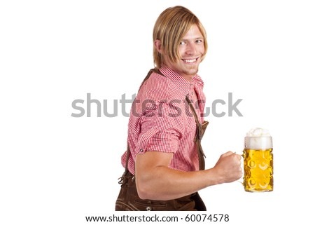 Bavarian man shows biceps muscles and holds oktoberfest beer stein.  Isolated on white background.