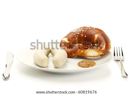 bavarian veal sausages on a plate with sweet mustard and pretzel on white background