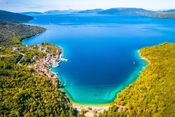 Bay and village of Valun on Cres island aerial view, idyllic beach and nautical destination on Adriatic coast of Croatia