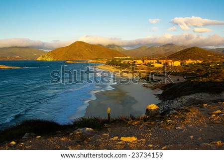 Bay at Island Margarita in sunset time near town Juan Griego with mountains in background