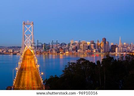 Bay Bridge and San Francisco downtown - stock photo