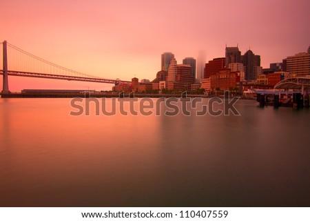 Bay Bridge and San Francisco panorama during sunset across the bay, USA