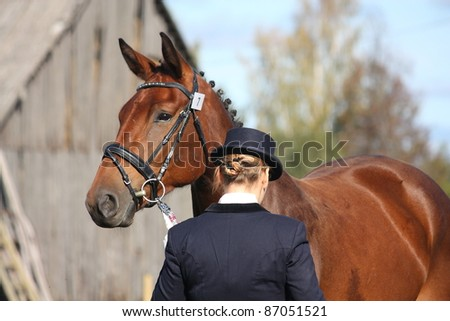 Bay horse portrait and its owner