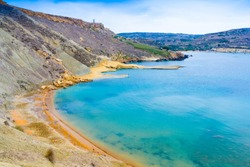 Bay near Ghajn Tuffieha in summer in the north-west coast of Malta