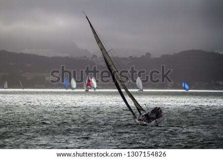 Bay Sailing - Sailboats cross San Francisco Bay with patchy clouded sky. San Francisco, California, USA