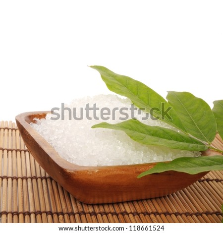 bay salt with green leave on wooden mat