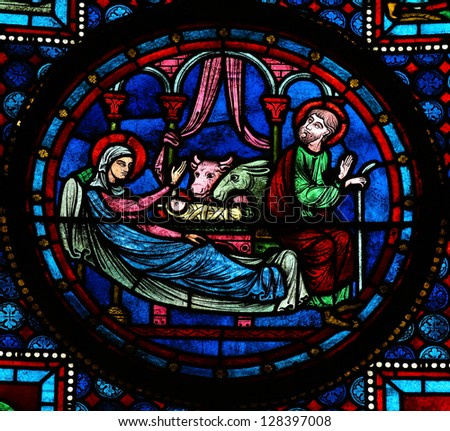 BAYEUX - FEBRUARY 12: Stained glass window depicting a Nativity Scene in Bethlehem, in the cathedral of Bayeux, Normandy, France on February 12, 2013.
