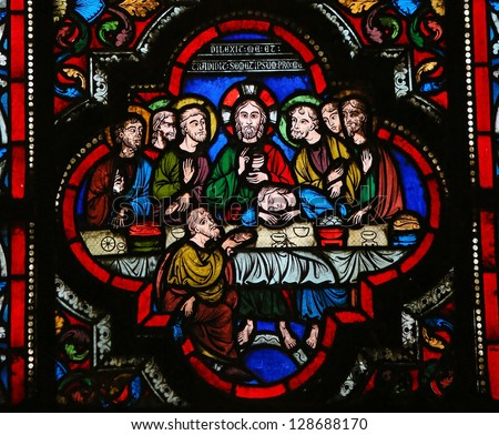 BAYEUX - FEBRUARY 12: Stained glass window depicting Jesus and his disciples at the Last Supper on Maundy Thursday, in the cathedral of Bayeux, Normandy, France  on February 12, 2013.