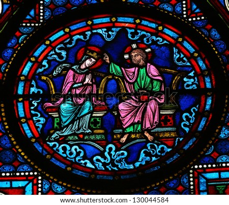 BAYEUX - FEBRUARY 12: Stained glass window depicting Jesus and Mother Mary in Heaven, in the cathedral of Bayeux, Normandy, France on February 12, 2013.