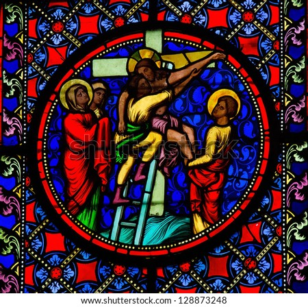 BAYEUX - FEBRUARY 12: Stained Glass window depicting Jesus taken from the cross, in Bayeux, Calvados, France on February 12, 2013.