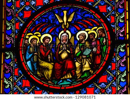 BAYEUX - FEBRUARY 12: Stained Glass window depicting Pentecost, in Bayeux, Calvados, France on February 12, 2013.