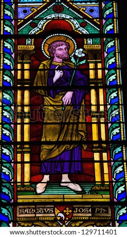 BAYEUX - FEBRUARY 12: Stained Glass window depicting Saint Joseph, in Bayeux, Calvados, France on February 12, 2013.