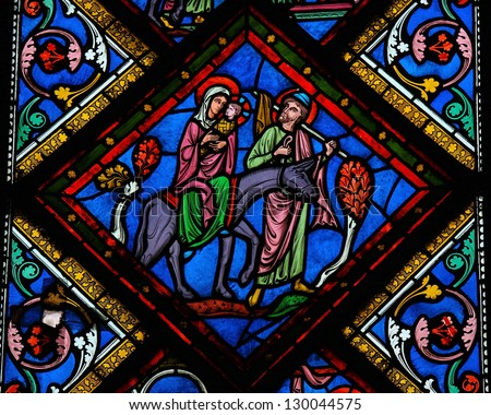 BAYEUX - FEBRUARY 12: Stained glass window depicting  the Holy Family in Bethlehem, in the cathedral of Bayeux, Normandy, France on February 12, 2013.