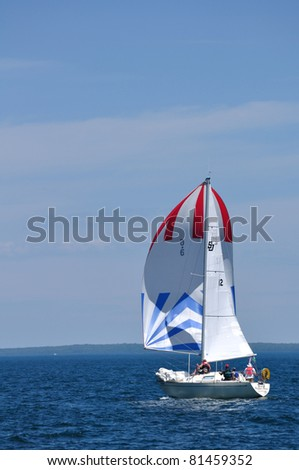 BAYFIELD, WI - July 4: The Sailboat Bigger Juan Skippered by Mark Shefchik Sailing in Annual Bayfield Race Week Competition on Lake Superior on July 4, 2011 near Bayfield, Wisconsin