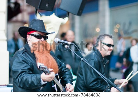 BAYONNE, FRANCE - MARCH 12: A rock band  ZZ Top imitating, playing in the street during carnivalcelebrations in Bayonne, March 12, 2011, Bayonne, France.