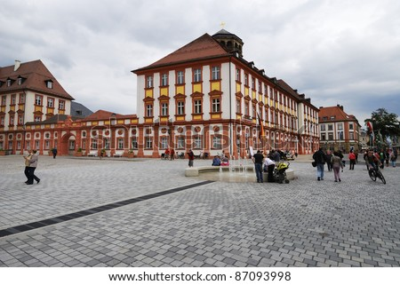 BAYREUTH, GERMANY - JUNE 25:Tourists in the Maximilian street in front of the old castle in  Bayreuth on June 25, 2011. Bayreuth is famous for its annual festival for operas of Richard Wagner.