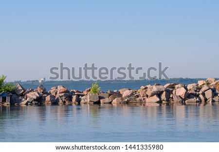 BBeautiful view of the seashore with natural stones. Little Cove for boatseautiful view of the seashore with natural stones. #1441335980