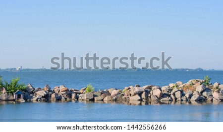 BBeautiful view of the seashore with natural stones. Little Cove for boatseautiful view of the seashore with natural stones. #1442556266