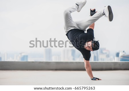 Bboy doing some stunts - Street artist breakdancing outdoors Stockfoto ©