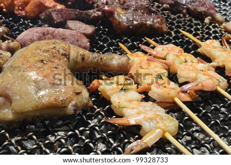 BBQ - Assorted meat on an outdoor BBQ grill. Close-up.