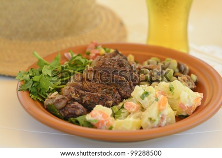 BBQ Beef - Grilled beef served with potato salad, salsa and black eyed pea salad. Churrasco Brasileiro.