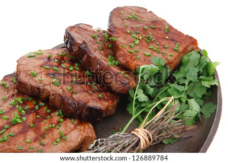 bbq beef meat fillet on pan isolated on white background