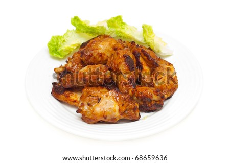 bbq chicken wings and salad onwhite