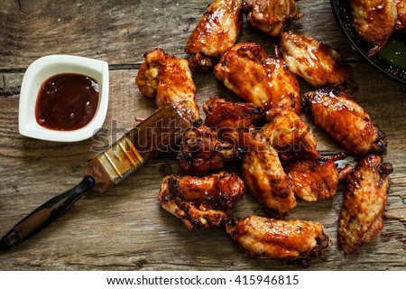 BBQ chicken wings with sauce for dip