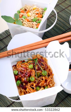 BBQ egg noodles and vegetable noodles in take away containers.
