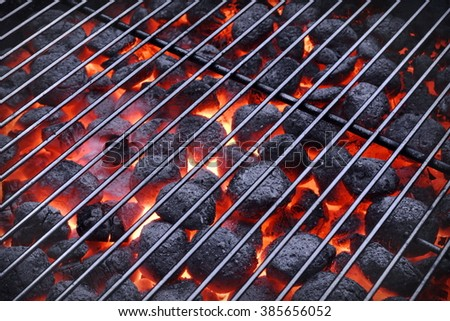 BBQ Grill And Glowing Hot Charcoal Briquettes In The Background, Close-Up, Top View. Concept For Outdoor Barbecue Party Or Picnic Or Cookout