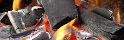 BBQ Grill Pit With Glowing And Flaming Hot Charcoal.