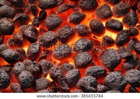 BBQ Grill Pit With Glowing And Flaming Hot Charcoal Briquettes, Food Background Or Texture, Close-Up, Top View #385655764
