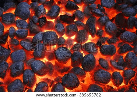 BBQ Grill Pit With Glowing And Flaming Hot Charcoal Briquettes, Food Background Or Texture, Close-Up, Top View #385655782