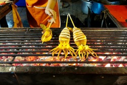BBQ grilled squid on a gridiron - street foods