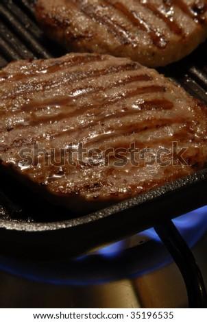 BBQ Hamburgers on the Grill. Hamburger meat.