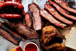 BBQ platter. Barbecue pork ribs, brisket, beef ribs and chicken served with classic bbq sides Mac n cheese, cornbread, Brussels sprouts, coleslaw & beer. Classic traditional Texas meats & side dishes.