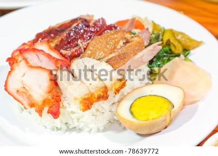 BBQ Pork, Duck and Crispy Pork with Rice. (Thai food) Closeup Useful as background for design-works. (Kao Che Po)