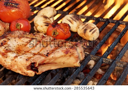 BBQ Pork Rib Pepper Steak, Tomato And Mushrooms On The Hot Flaming Charcoal Grill