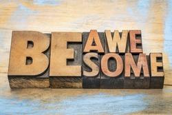 be awesome words in vintage letterpress wood type blocks against grunge painted wood