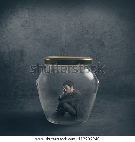 Be ermetic concept with a businessman closed in a jar