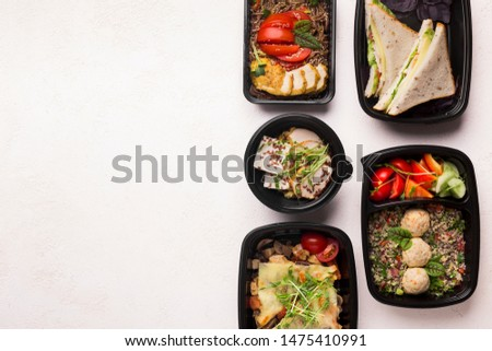 Be healthy. Healthy food delivery in black boxes to go on white background with copy space for advertisement