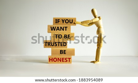 Be honest symbol. Wooden blocks with words 'If you want to be trusted be honest'. Wooden model of human. Beautiful white background, copy space. Business and be honest concept. Сток-фото ©