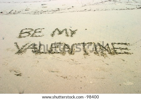 BE MY VALENTINE written in sand on the beach just in time for Valentines day
