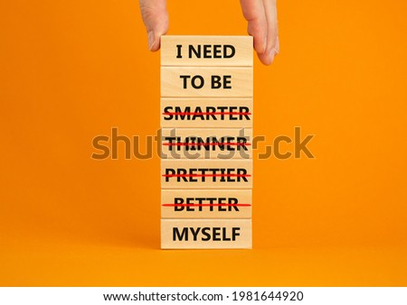 Be myself symbol. Businessman hand. Wooden blocks with words 'i need to be myself, not smarter, thinner, prettier, better'. Beautiful orange background, copy space. Psychological, be myself concept. Stock photo ©
