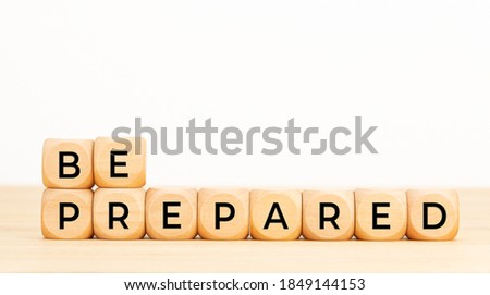 Be prepared phrase in wooden blocks on table. White background. Copy space ストックフォト ©