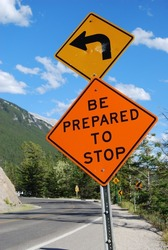 Be prepared to stop road sign on mountain bend