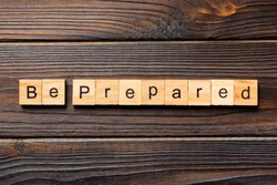 BE PREPARED word written on wood block. BE PREPARED text on wooden table for your desing, concept.