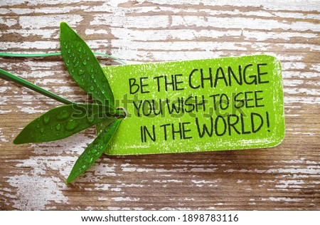 Be the change you wish to see in the world! - Text on natural label Stock photo ©