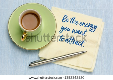 Be the energy you want to attract - handwriting on napkin with a cup of coffee, law of attraction concept #1382362520